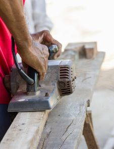 Free Carpenter Working With Electric Planer Stock Images - 27656014