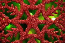 Free Red Snowflake On Green Blurred Background Royalty Free Stock Image - 27657486