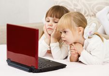 Free Two Little Girls Are With A Laptop Royalty Free Stock Image - 27659006