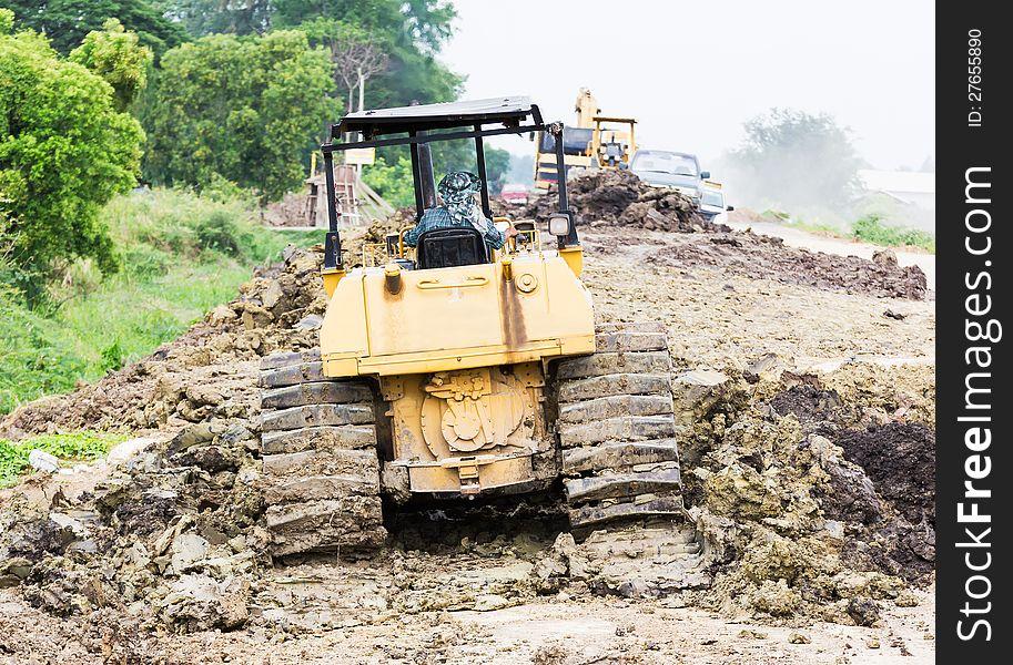 Bulldozer in construction site