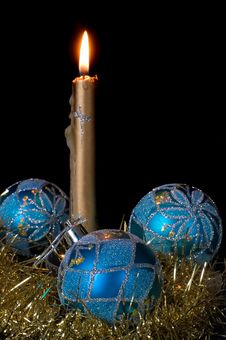 Burning Candle And Christmas Balls Royalty Free Stock Images