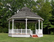White Wooden Gazebo Bandstand In Park. Stock Photo