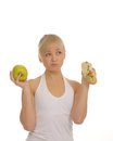 Free Slim Woman Choosing Between Apple And Hamburger Royalty Free Stock Images - 27679209