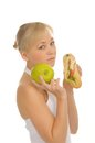 Free Slim Woman Choosing Between Apple And Hamburger Royalty Free Stock Photography - 27679267