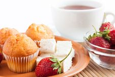 Cheese Cupcakes And A Cup Of Tea Royalty Free Stock Photo