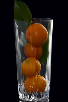 Glass And Mandarins Royalty Free Stock Images