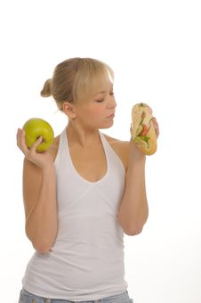 Free Slim Woman Choosing Between Apple And Hamburger Royalty Free Stock Image - 27679166