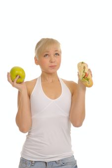 Free Slim Woman Choosing Between Apple And Hamburger Royalty Free Stock Photos - 27679178