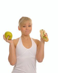 Free Slim Woman Choosing Between Apple And Hamburger Royalty Free Stock Image - 27679206