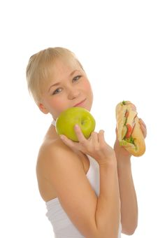 Free Slim Woman Choosing Between Apple And Hamburger Stock Photography - 27679232