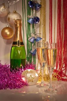 Free New Year Decorations With Two Glasses And Bottle O Stock Photos - 27679393
