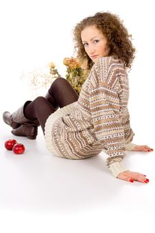 Free Girl Sits In A Cozy Sweater Isolated Stock Images - 27690144