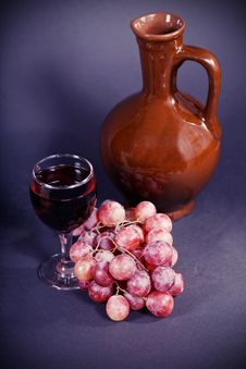 Glass And A Jug Of Red Wine Stock Image