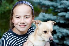 Free Smiling Girl And Dog Stock Image - 2775401