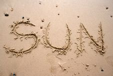 Sand Writing - SUN Royalty Free Stock Photos