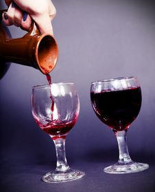 Free Pouring Wine From An Ancient Pitcher Stock Images - 27711504