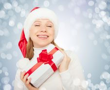Beautiful Woman  In Christmas Hat With Gift Stock Photos