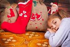 Free Little Girl With A Christmas Gift Stock Photos - 27716863
