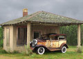Free Old Vintage Car By A Small Building Stock Photography - 27726952