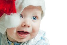Free Portrait Of A Baby In A Christmas Hat Stock Photo - 27720360