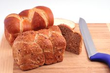 Free Two Loaves Of Bread And A Knife On A Board Royalty Free Stock Photo - 27722845