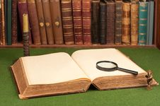 Leather Books, Candlestick, Magnifying Glass Royalty Free Stock Photos