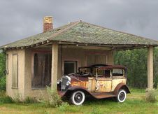 Old Vintage Car By A Small Building Stock Photography