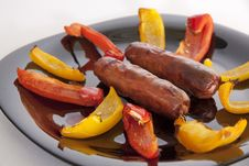 Grilled Sausages And Colorful Peppers Stock Photos
