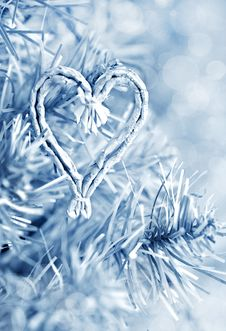 Fir Branch And Heart Shape In Blue Stock Images