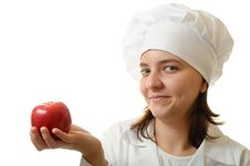 Smiling Chef With An Apple Royalty Free Stock Photography