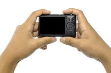 Free Hand Holding Compact Camera Royalty Free Stock Photography - 27751407