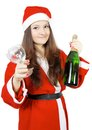 Free Cute Teen Girl Dressed As Santa With Champagne Stock Photos - 27760543