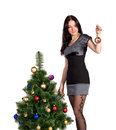 Free Brunette Girl Decorates The Christmas Tree Balls Stock Photos - 27768713