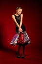 Free Sexy Girl In A Black Dress With Bags In Hands Stock Images - 27769194