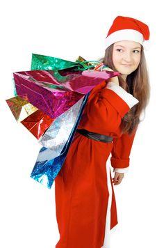 Cute Girl Dressed As Santa Brings Gifts Royalty Free Stock Image