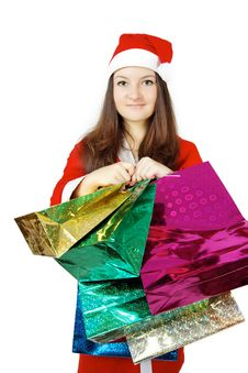 Free Pretty Teen Lady Dressed As Santa With Presents Royalty Free Stock Image - 27760476