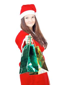 Free Pretty Teen Girl Dressed As Santa Gives Gifts Royalty Free Stock Image - 27760646