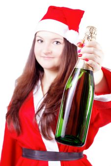 Free Girl Dressed As Santa Offers Champagne Royalty Free Stock Image - 27760716