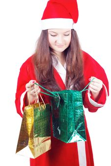 Free Pretty Teen Girl Dressed As Santa Looks Gifts Royalty Free Stock Photo - 27760725