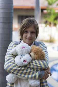 Girl Teenager With Soft Toys. Royalty Free Stock Images