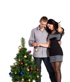 Men And Women Decorates The Christmas Tree Royalty Free Stock Photography