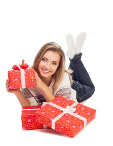 Young Woman Holding Gift, Lies On W Royalty Free Stock Photography