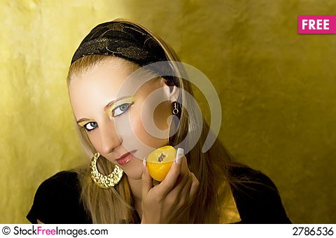 Free Attractive Girl With Apricot Royalty Free Stock Image - 2786536