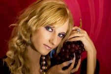 Blond Girl With Grapes Royalty Free Stock Photos