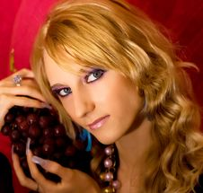 Blond Girl With Grapes Bunch Royalty Free Stock Photography