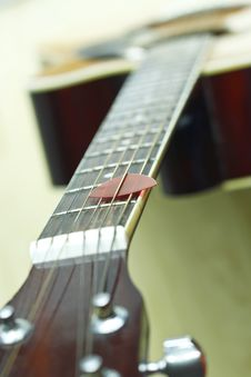 Guitar Pick On The Fingerboard Royalty Free Stock Image