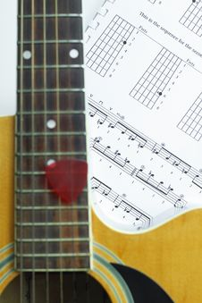 Acoustic Guitar On Music Note Sheet Royalty Free Stock Images