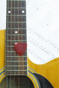 Acoustic Guitar On Music Note Sheet Stock Images