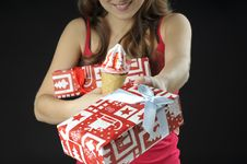 Christmas  Girl  Holds  Gift Boxes And Ice Cream Stock Photography