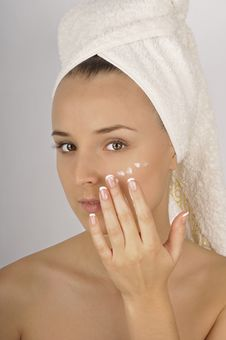 Beautiful Woman Applying  Cream On Face. Stock Images